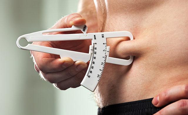 Using a caliper to measure body fat.