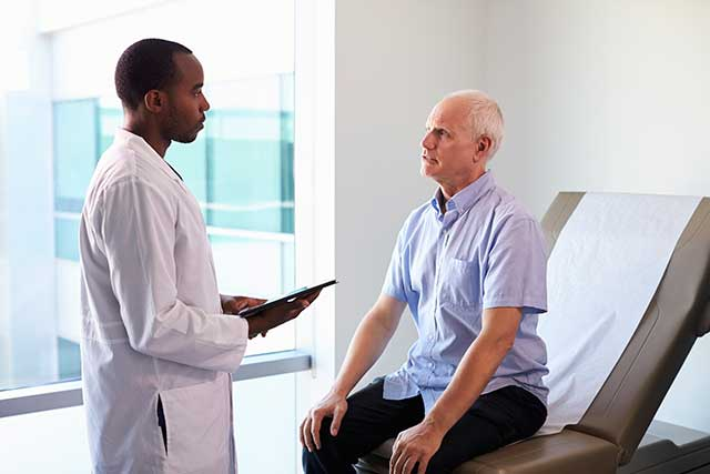 A patient consultation regarding course of treatment.