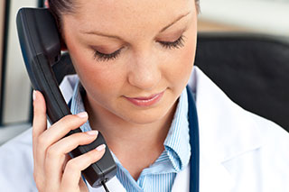 Providing telephone support to patients.