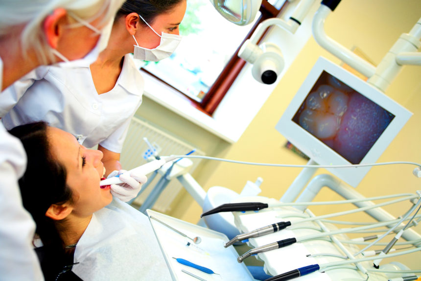 A patient with cancer undergoes preoperative oral care.