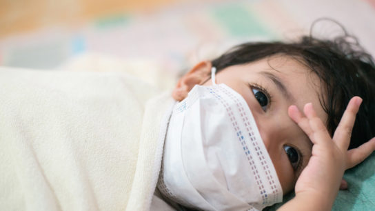 Child patient with mask.