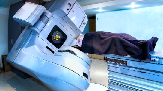 Patient receiving radiation therapy for cancer treatment in linear acelerator
