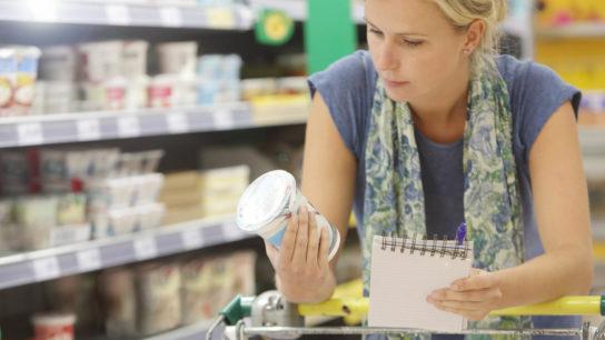 A cancer survivor examines a food label.