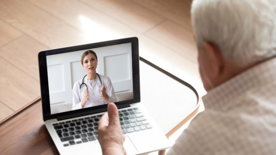 Senior male having a telemedicine visit