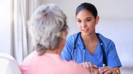 Nurse comforts a patient.