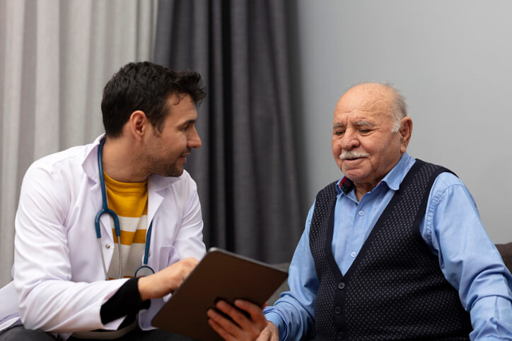 Male patient talking to doctor.
